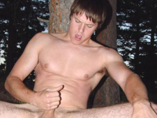 Guy jerking off his cock outdoors in the woods